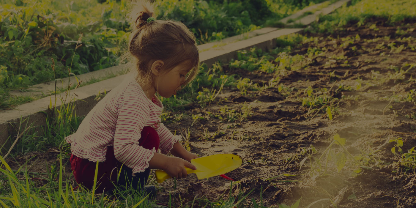 Little girl playing in garden